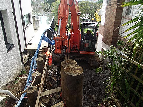 Drilling for retaining in limited space between two houses in Remuera, Auckland