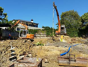 Earthmoving contractors performing drilling