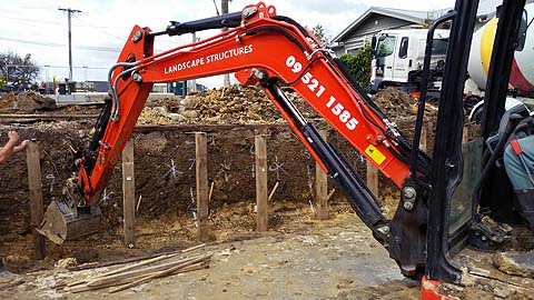 Earthmoving contractors in Auckland constructing a new retaining wall