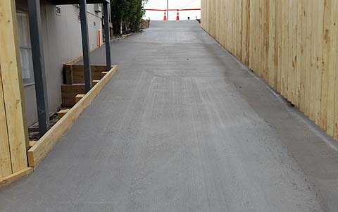 Freshly poured concrete driveway in Auckland